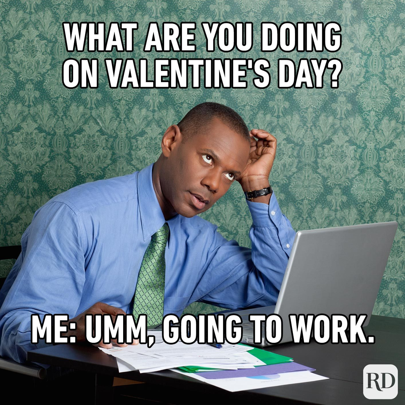 Man in office. Meme text: What are you doing on Valentine's Day? Me: Umm, going to work.