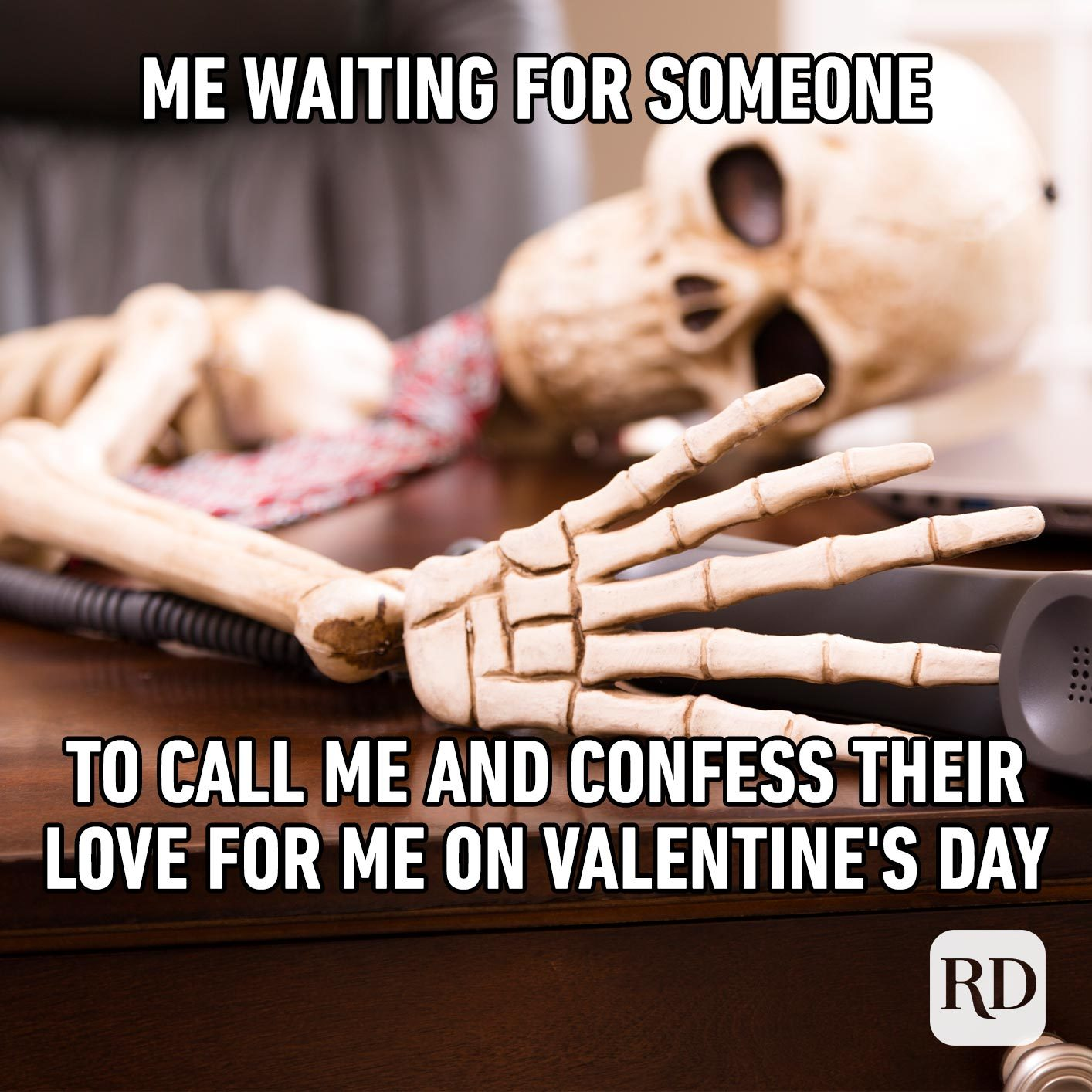 Skeleton on phone. Meme text: Me waiting for someone to call me and confess their love for me on Valentine's Day.