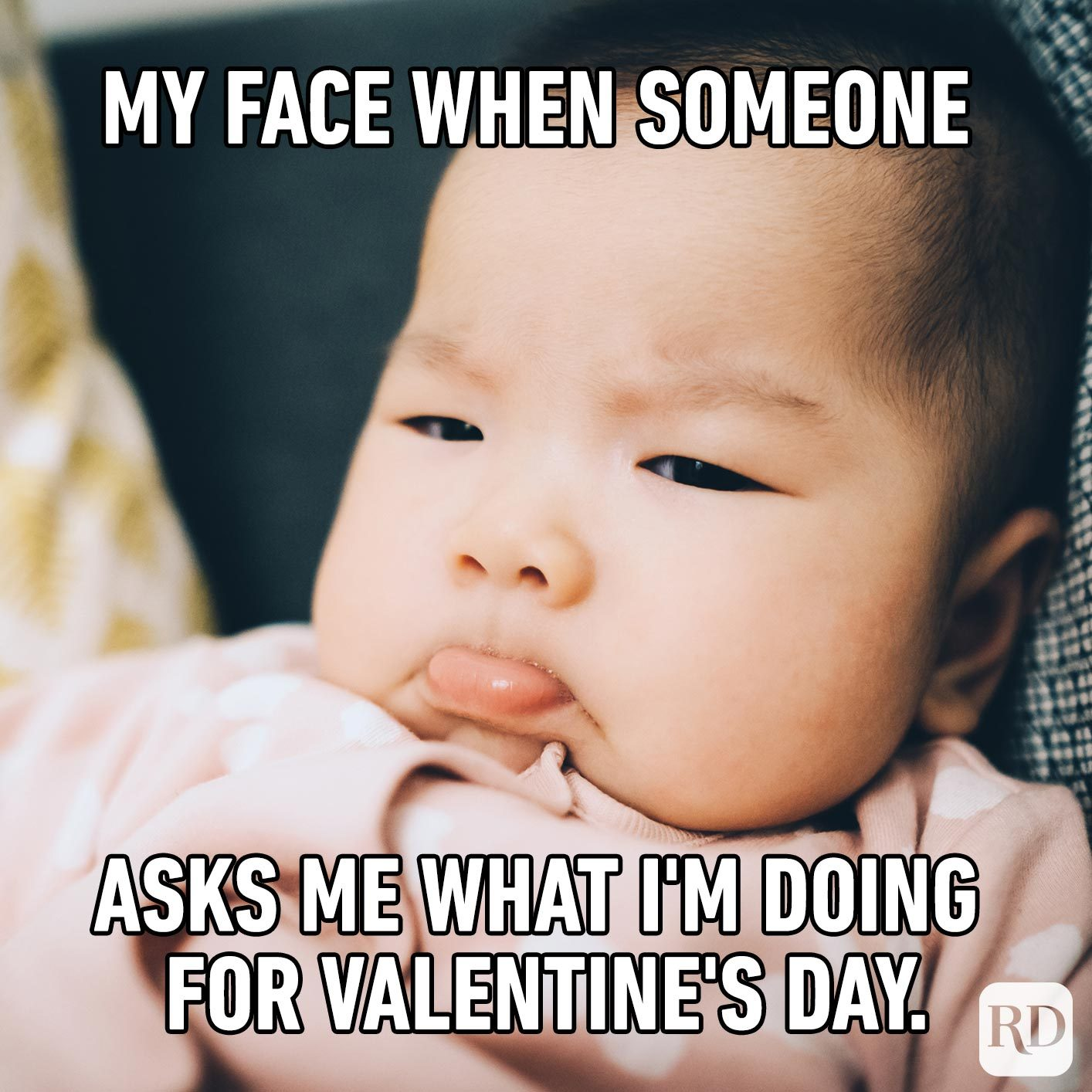 Baby sticking out tongue angrily. Meme text: My face when someone asks me what I'm doing for Valentine's Day.