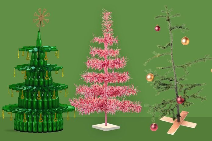 Three atypical Christmas trees: one made from cans, a pink one, and a Charlie Brown tree