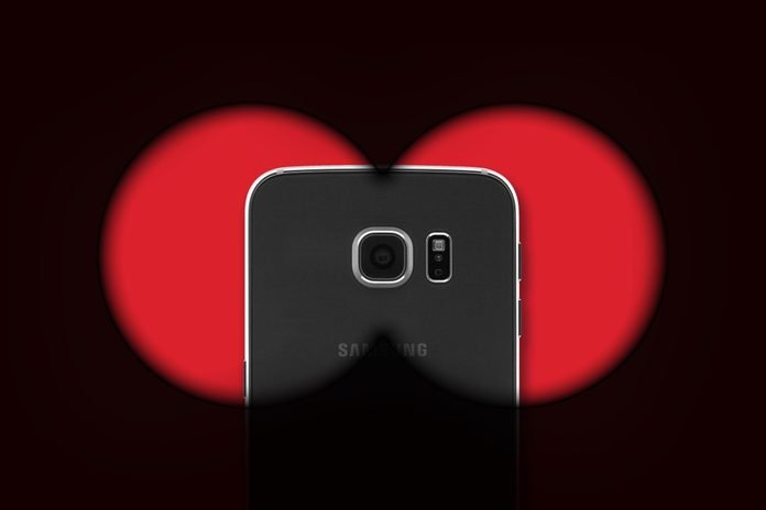 Android phone behind the dark view of binoculars, to represent malware or spyware
