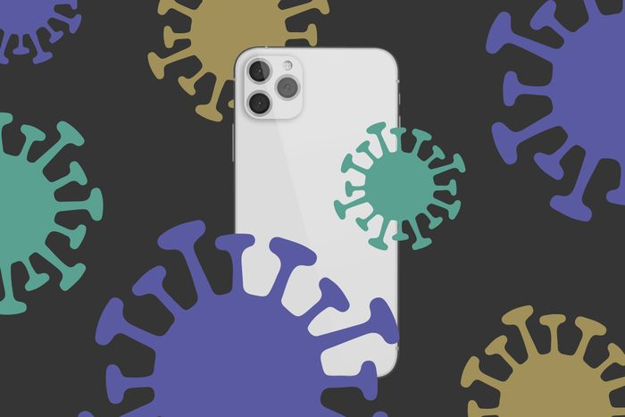 iPhone 12 surrounded by virus molecules on a dark background