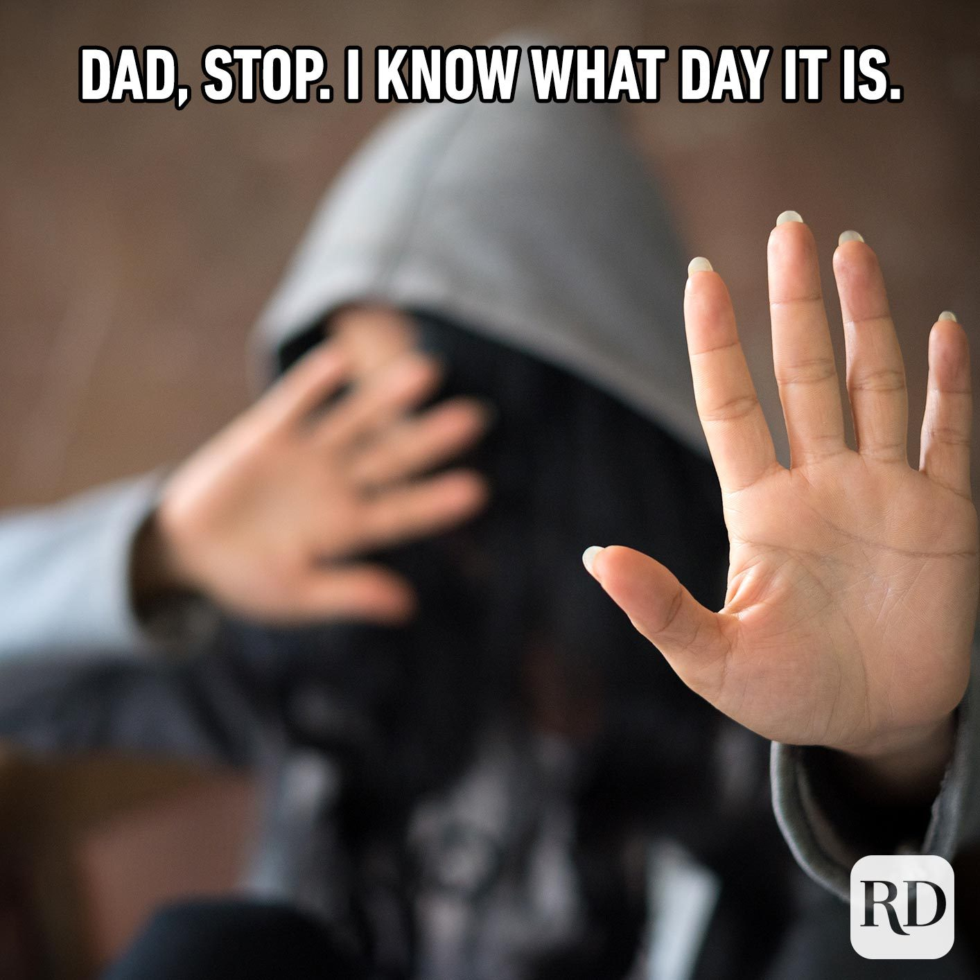 Person holding hand toward the camera. Meme text: Dad, stop. I know what day it is.