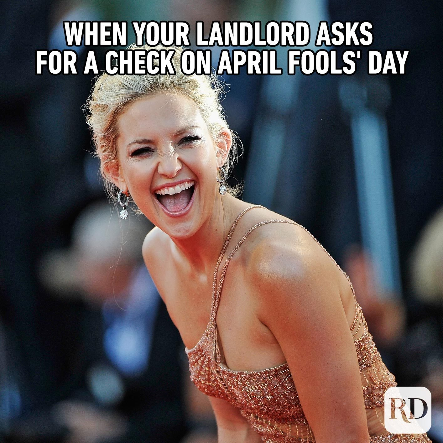 Woman laughing. Meme text: When your landlord asks for a check on April Fools' Day