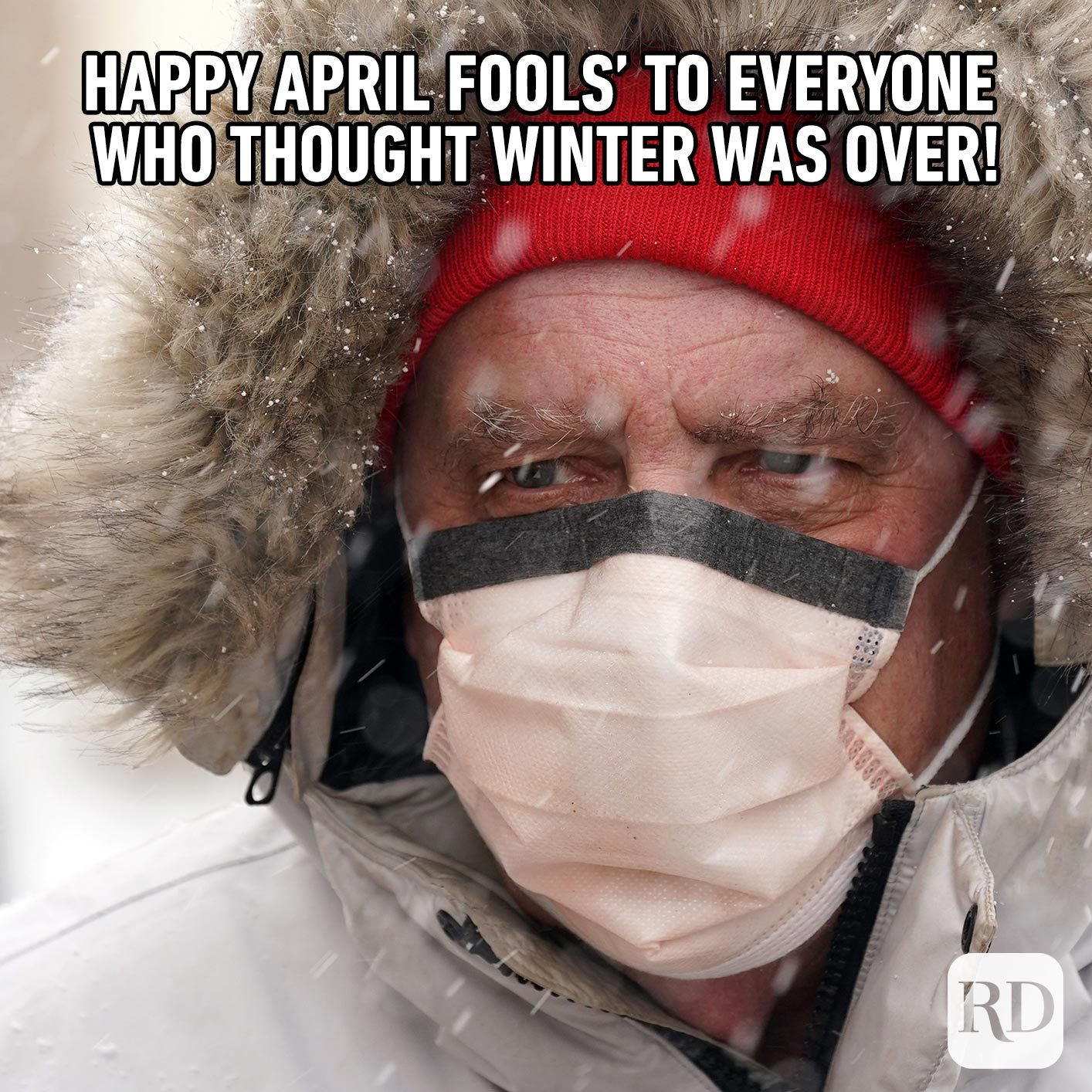 Man wearing a mask in the snow. Meme text: Happy April Fools' to everyone who thought winter was over!