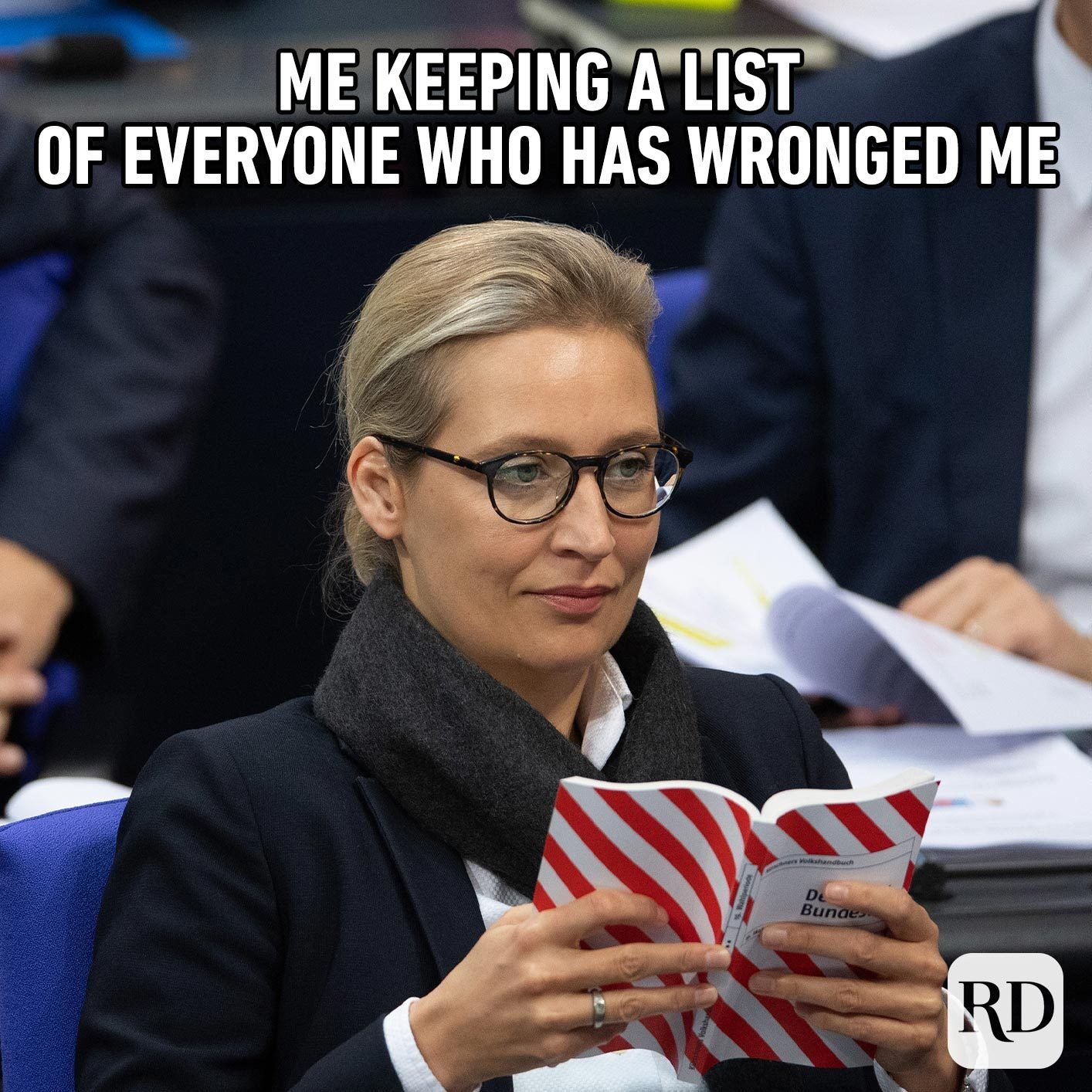 Woman looking skeptically at paper. Meme text: Me keeping a list of everyone who has wronged me