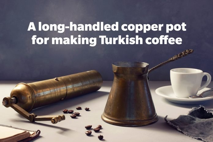 A long-handled copper pot for making Turkish coffee