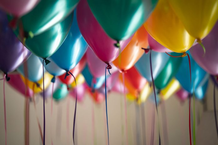 Close-Up Of Colorful Balloons Hanging At Home