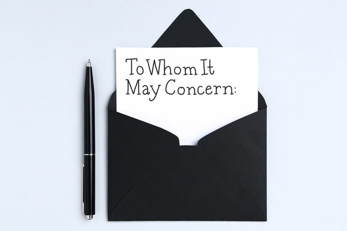 """a pen and envelope with a paper sticking out that reads, """"To Whom It May Concern:"""" in handwriting"""