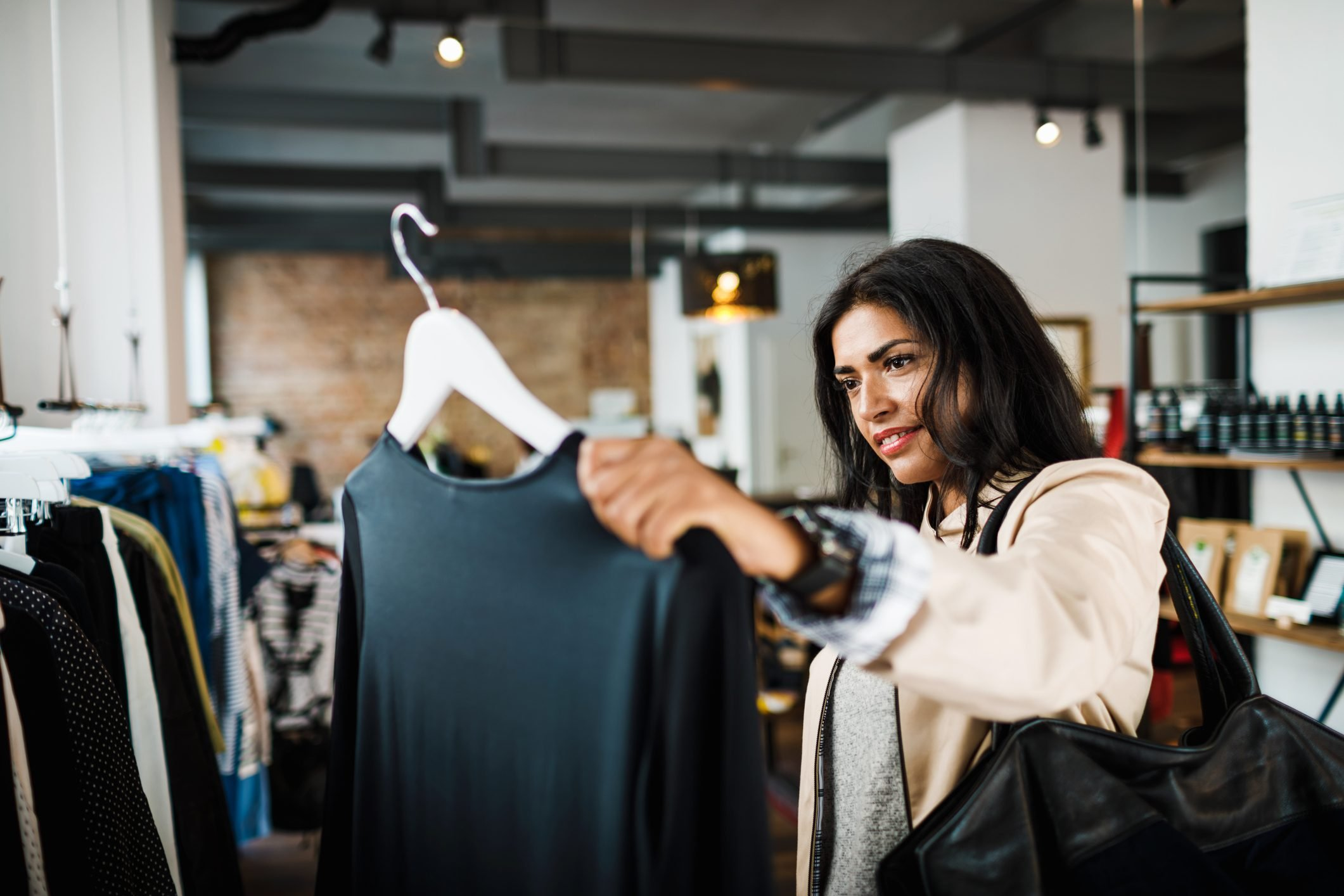Woman Looking At Blouse While Out Shopping