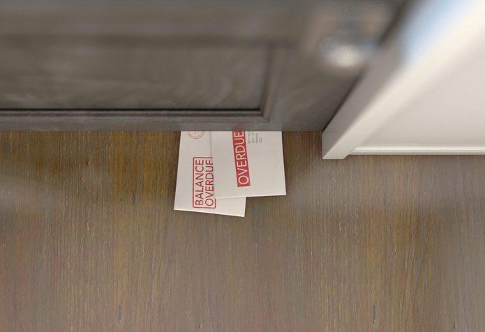 Debt Envelope Stack Under Door