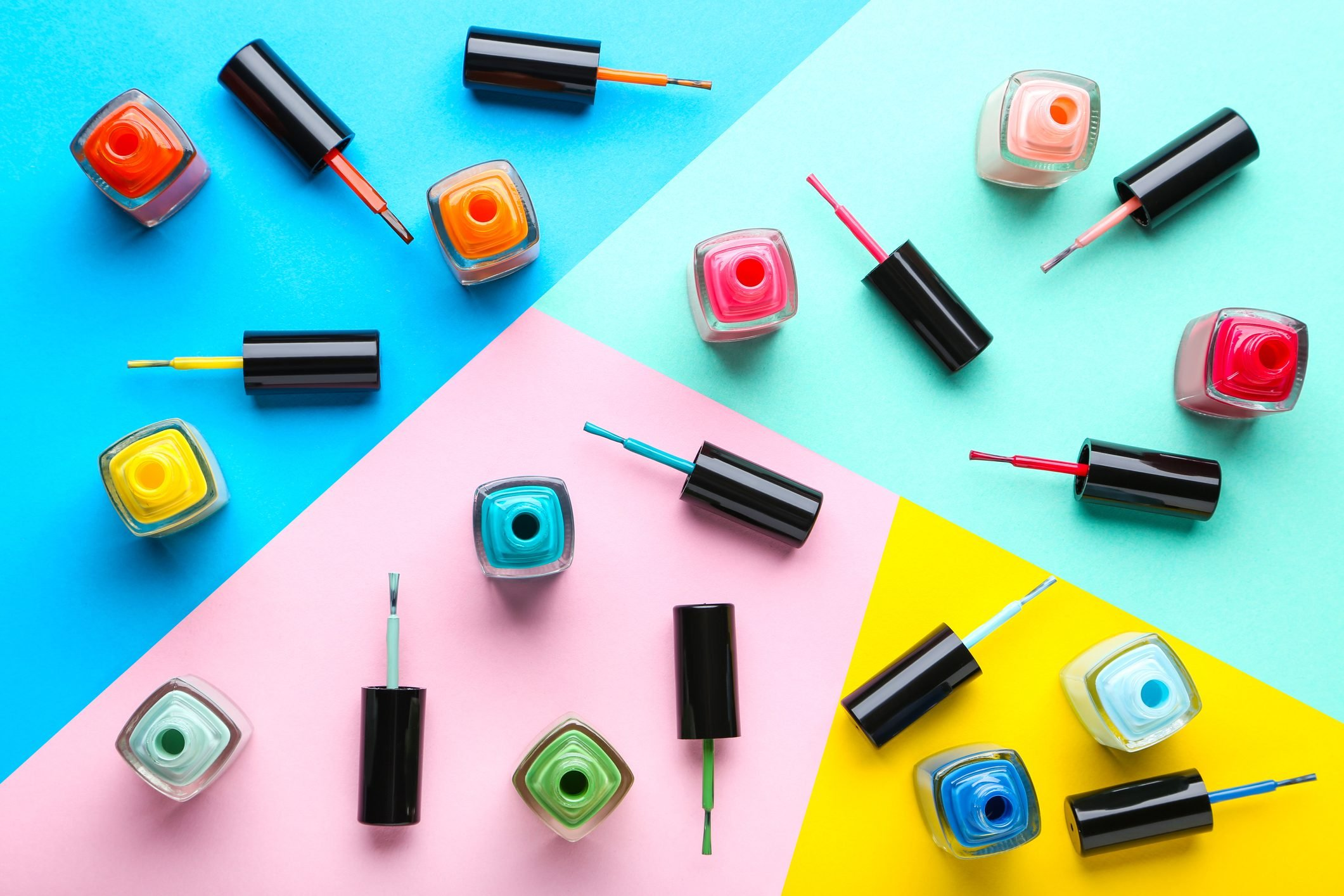 Nail polish bottles on colorful background