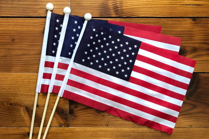 American US small flags on wooden background