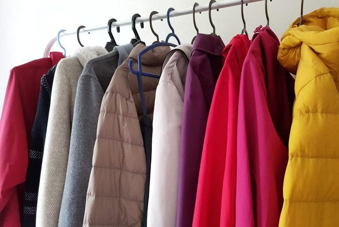 Clothes Hanging On Rack In Store
