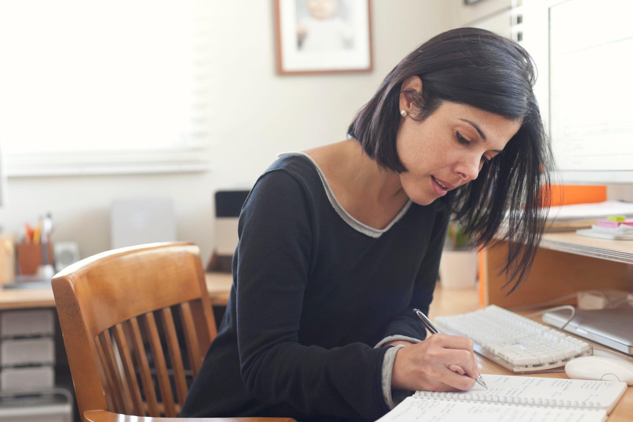 Hispanic woman working in home office