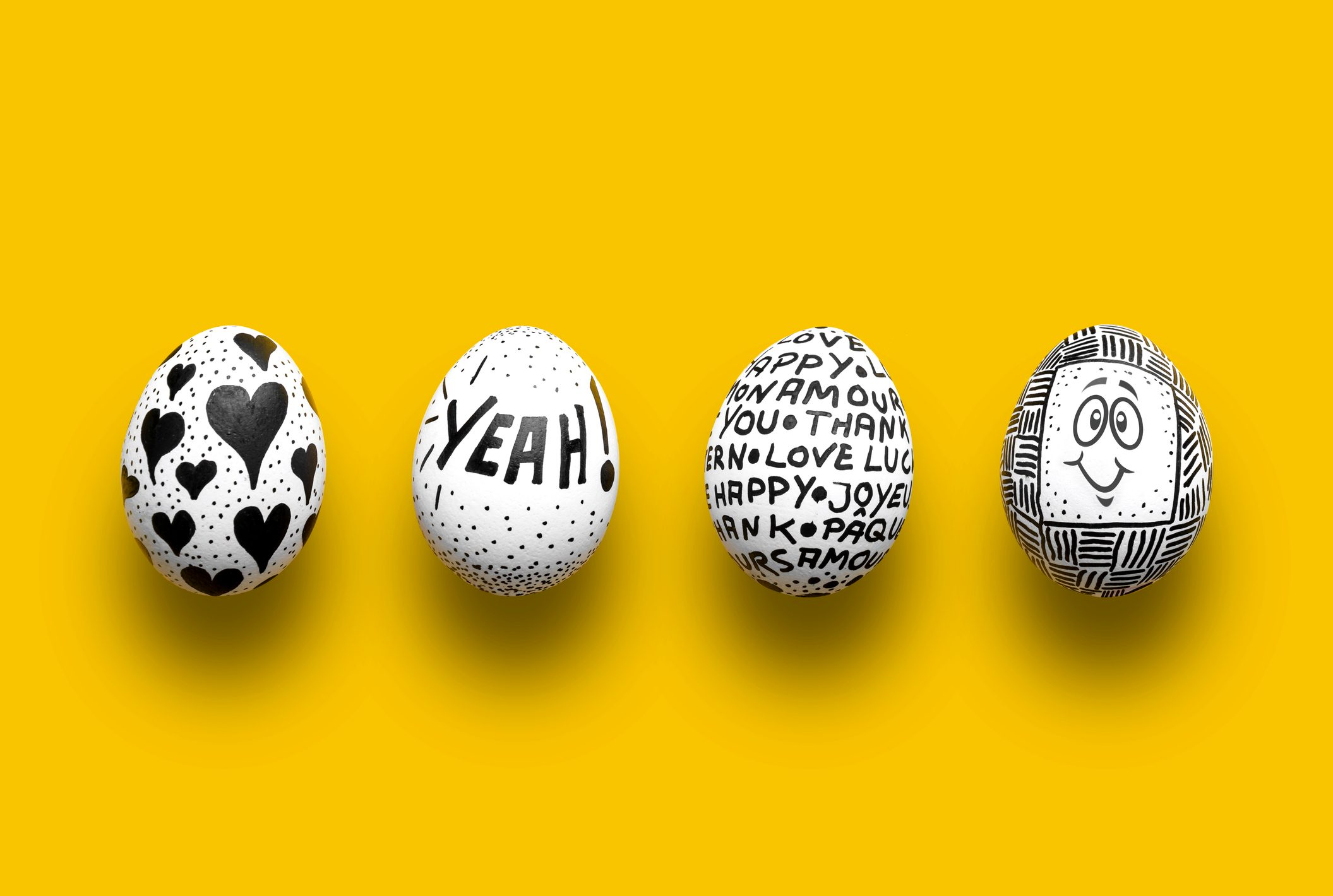 Painted Easter eggs on yellow background