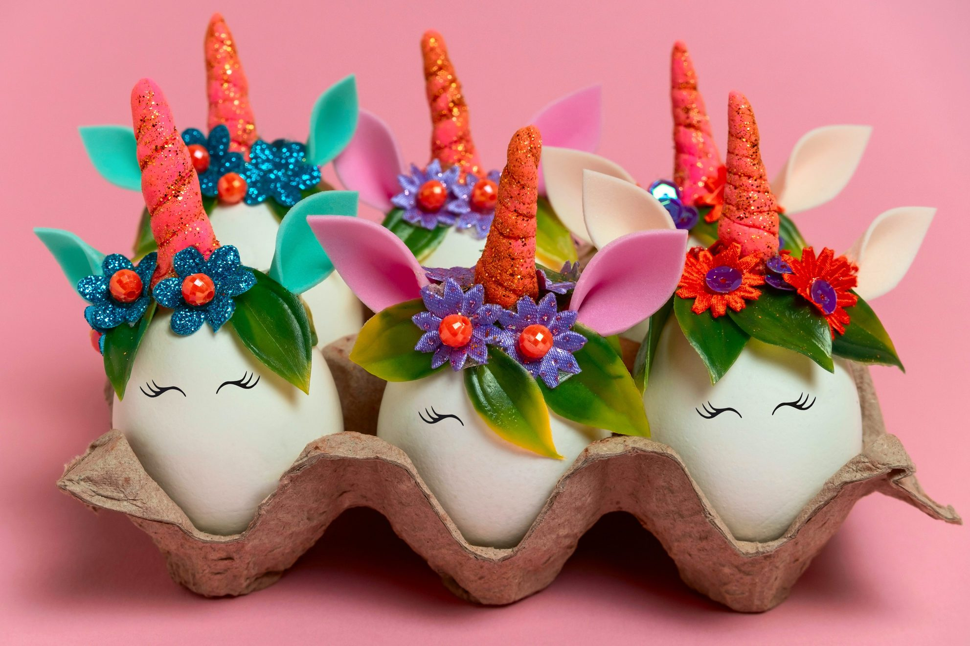 unusual Easter unicorn eggs on a pink background