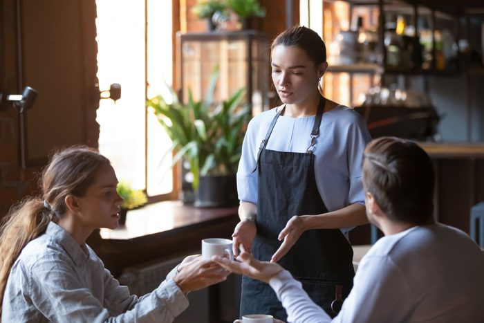 Angry client couple complain about bad service to waitress