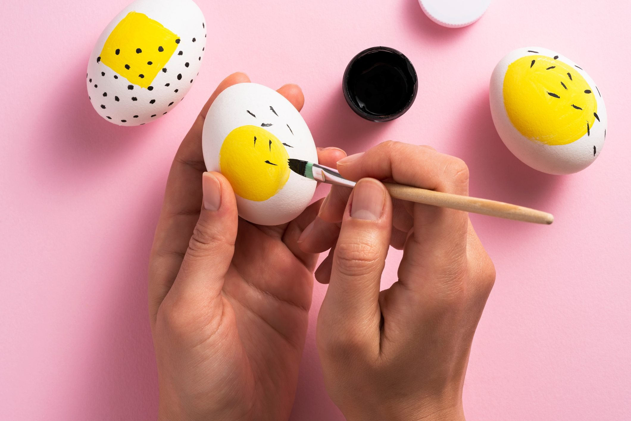Painting easter eggs with a large yellow spot on each