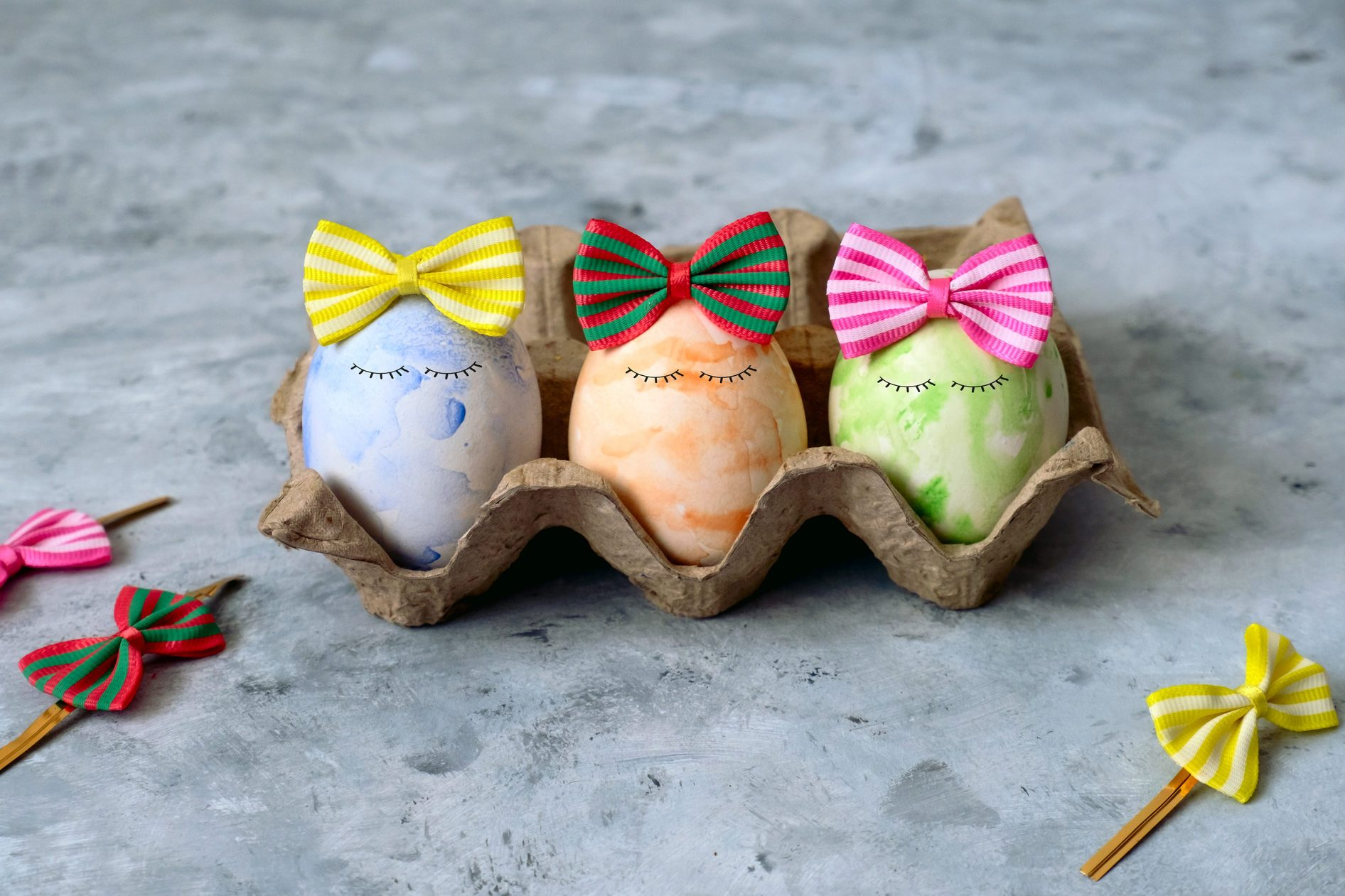 cute blue,orange and green Easter eggs in funny bows