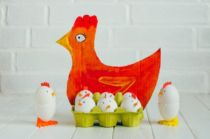 Easter decoration painted paper hen and chickens from eggs in the birdcage