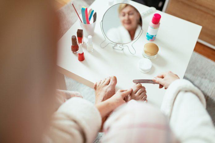 Mature woman having beauty treatment at home