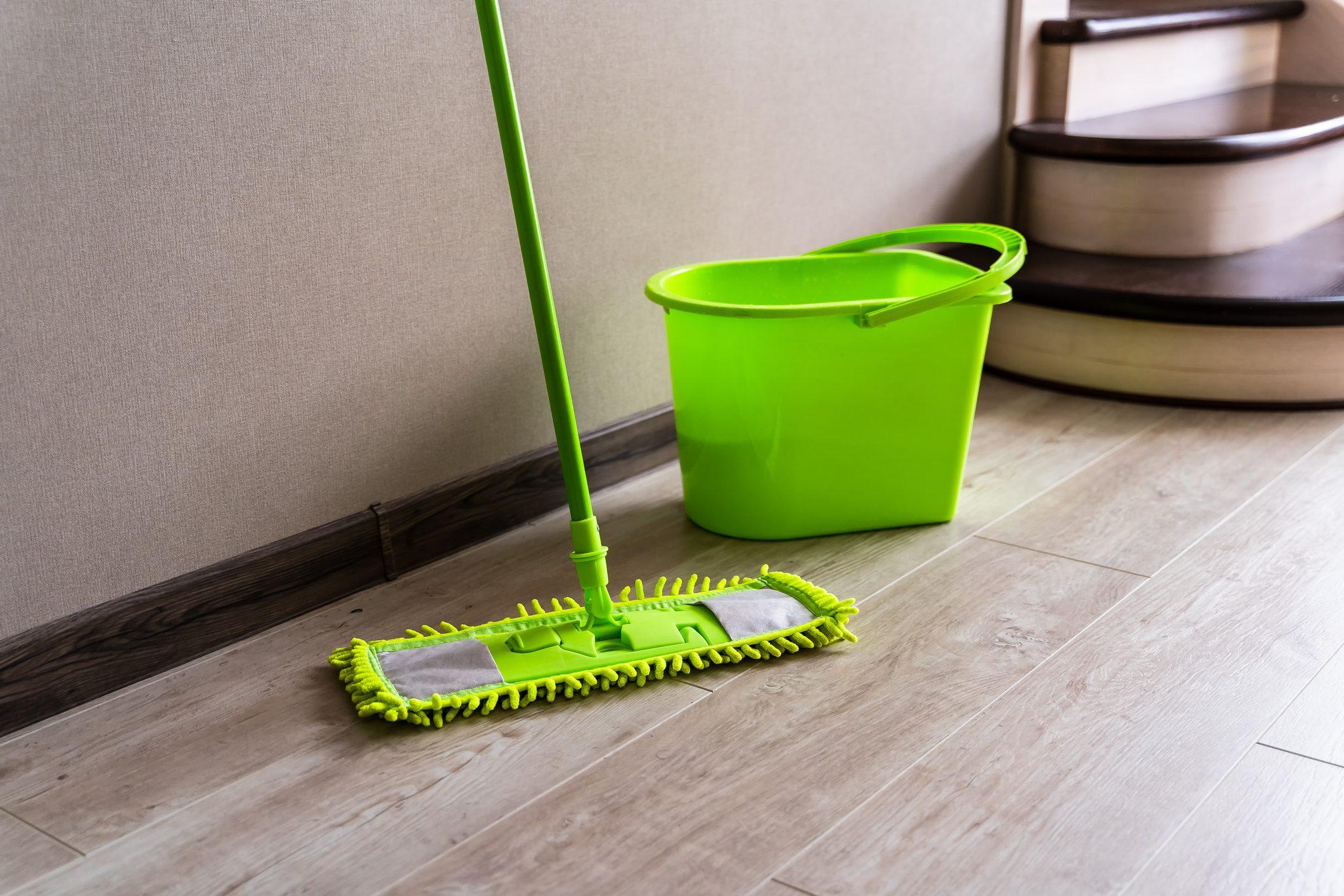 Mop with green microfiber rag, green plastic handle and bucket.