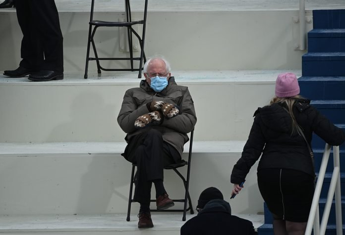the meme-worthy image of Bernie Sanders seated with arms crossed and mittens at Joe Biden's inauguration, January 20, 2021