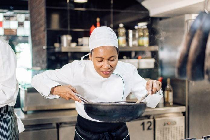 Female chef enjoying cooking