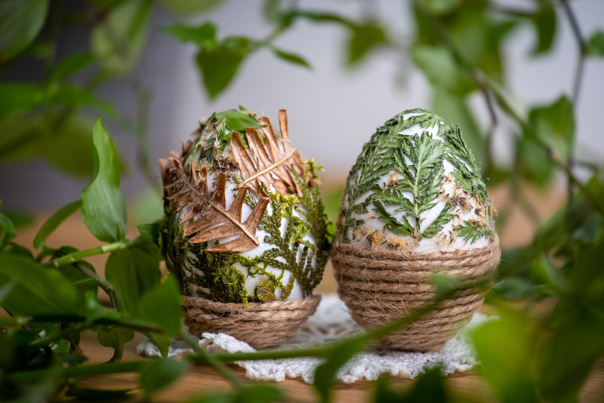 Forest themed Easter eggs decorated with natural leafs