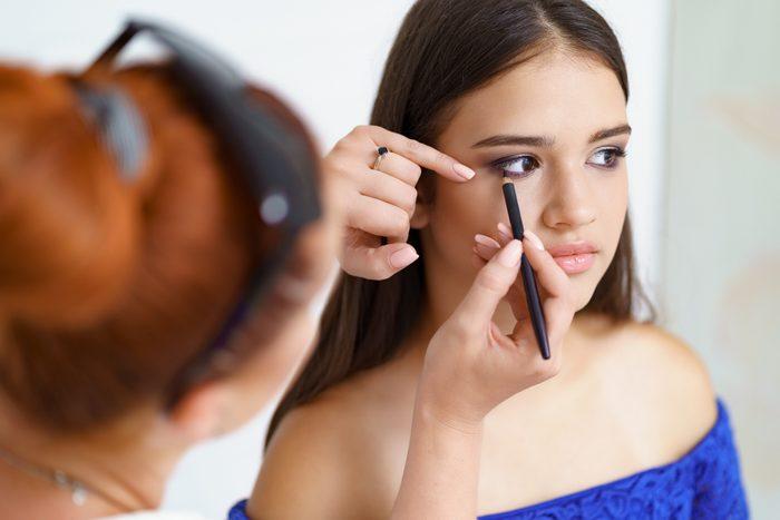 Make up artist work in her beauty visage studio salon