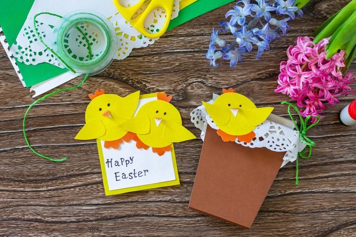 Child gift postcard happy easter chickens toy on a wooden table. Handmade. Project of childrens creativity, handicrafts, crafts for kids.