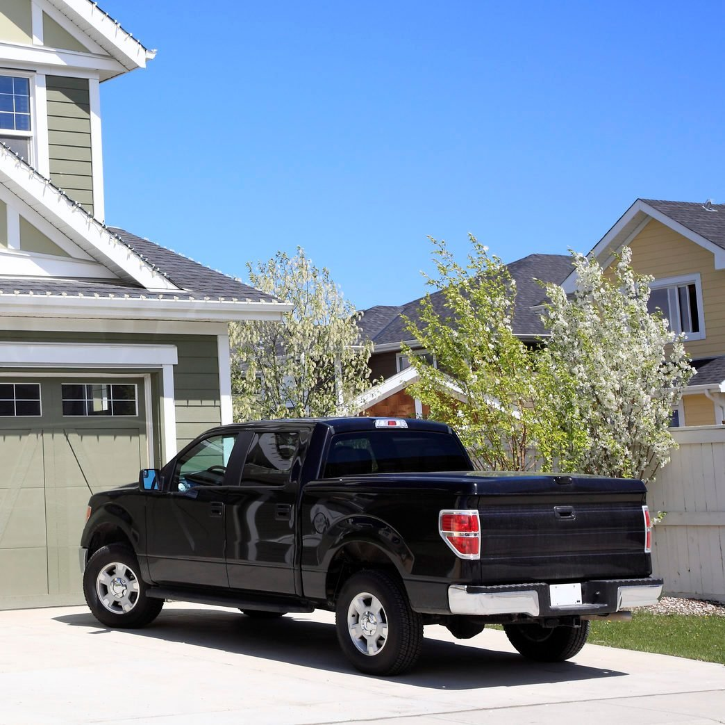 a black pick up truck in the driveway