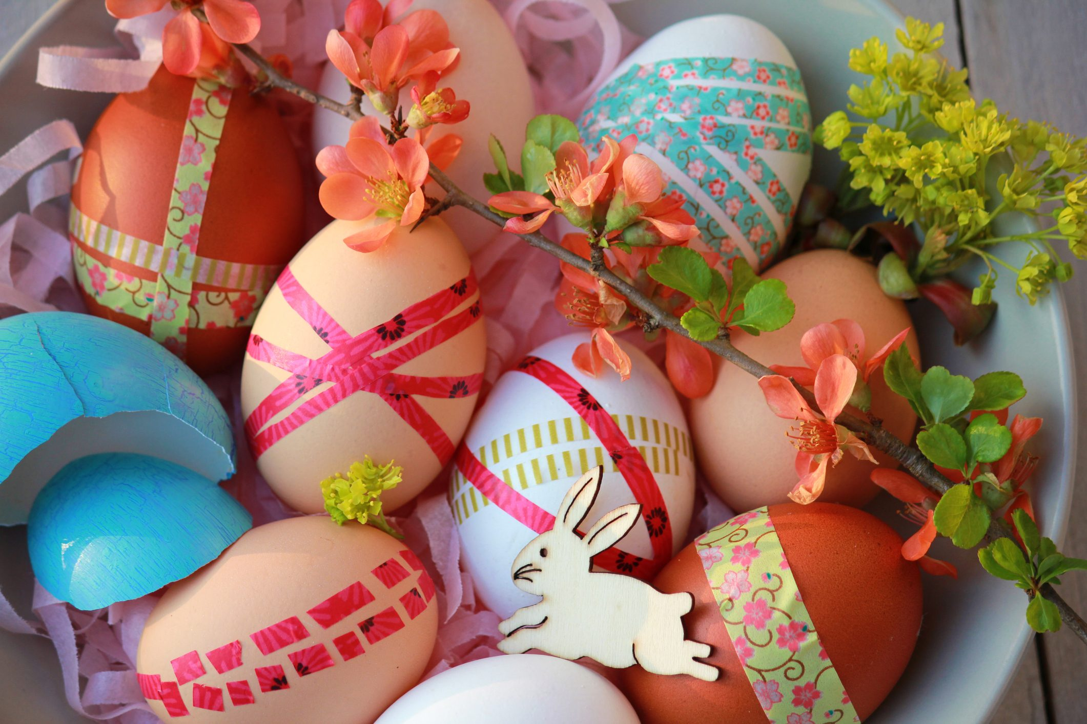 Easter eggs decorated with washi tape on wooden background