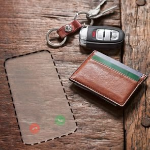 keys, wallet, and a space for a missing phone that may have been stolen or lost