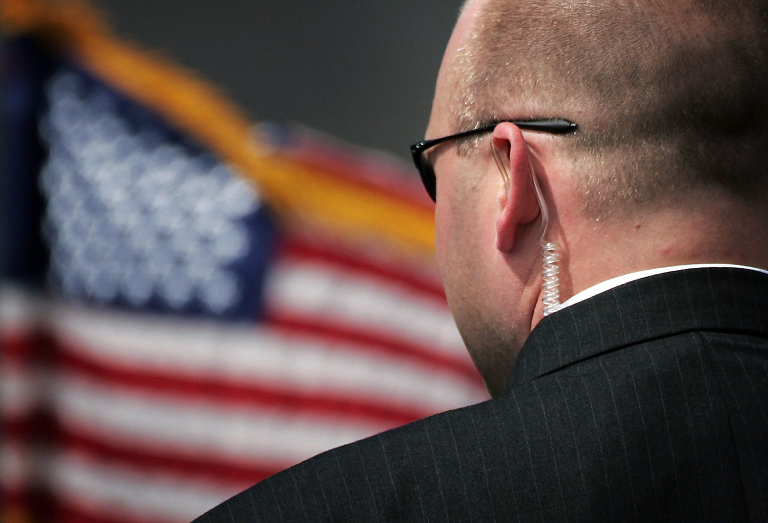 close up of secret service agent from behind