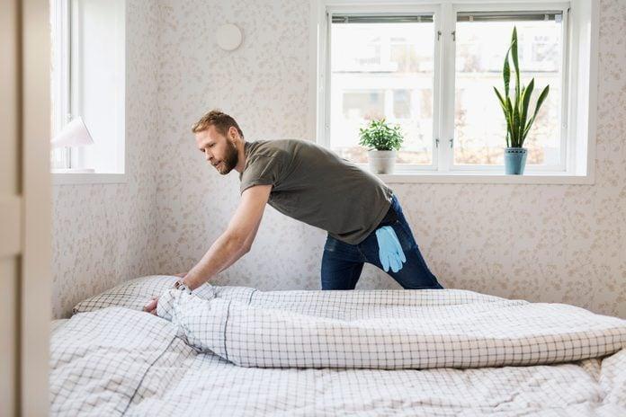 Man making bed