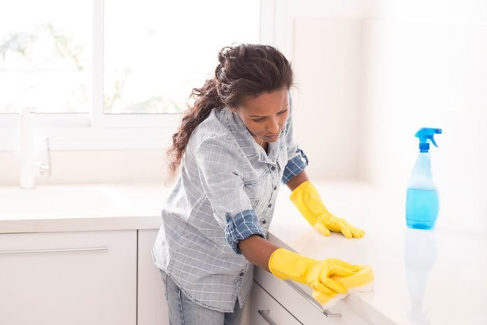Woman cleaning the kitchen.