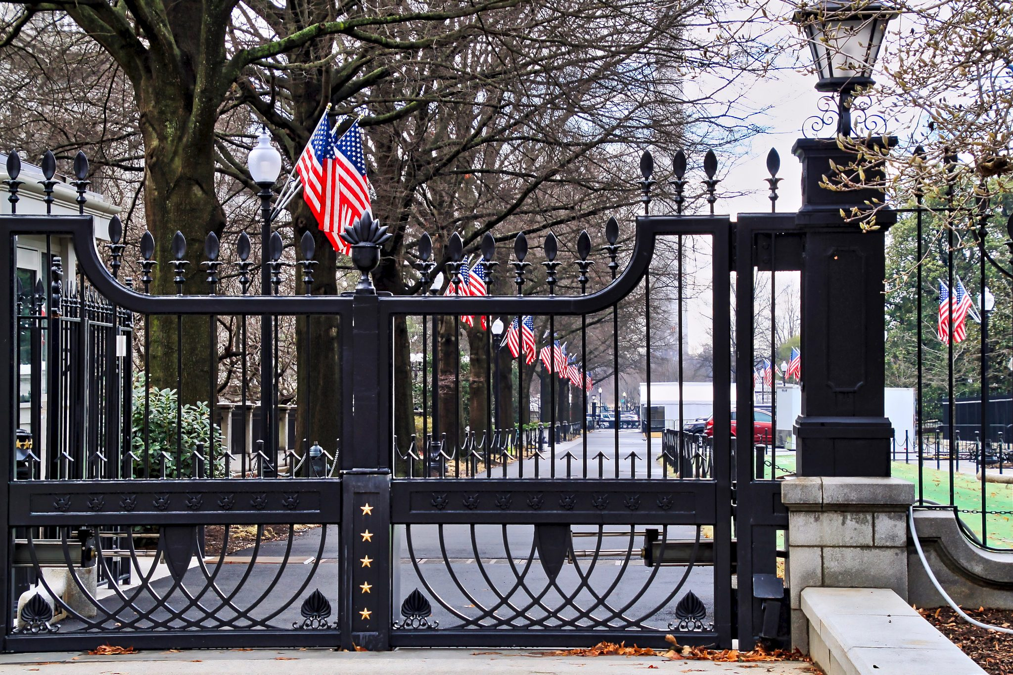 American Flags line drive inside gated White House grounds in Washington DC.