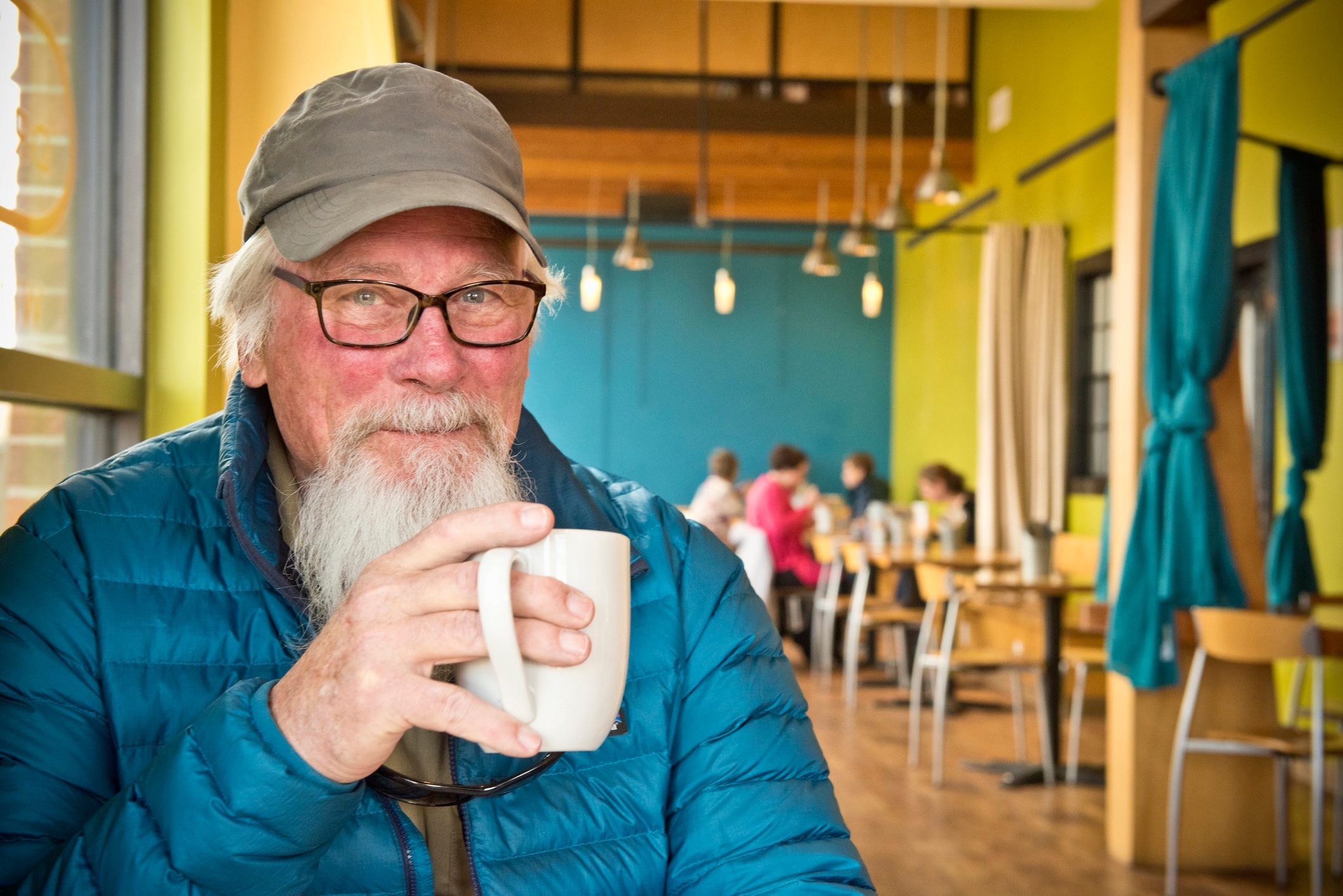 Active senior enjoying coffee in cafe in Montana