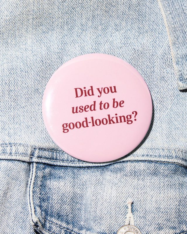 """denim jacket detail with a button that says, """"Did you used to be good looking?"""""""