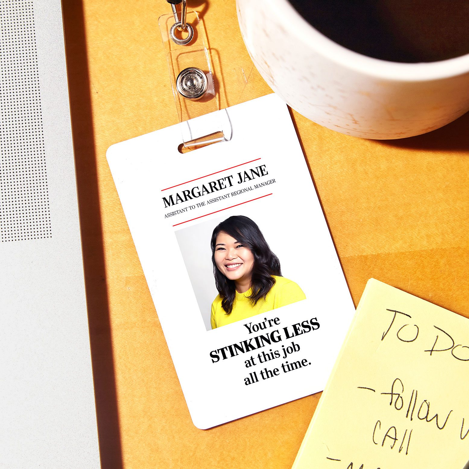 """office id badge that reads, """"You're STINKING LESS at this job all the time."""""""