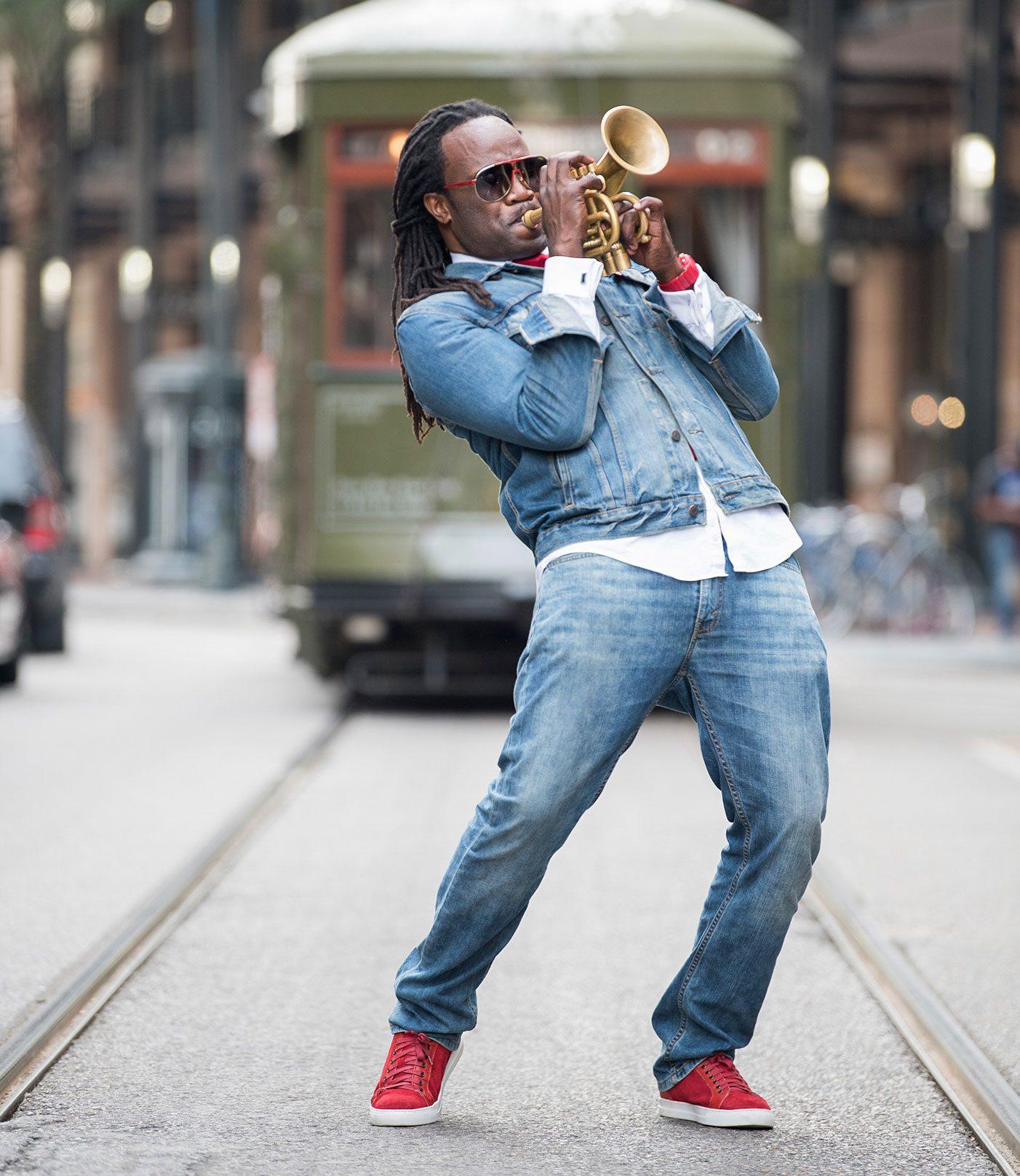 Shamarr Allen playing the trumpet