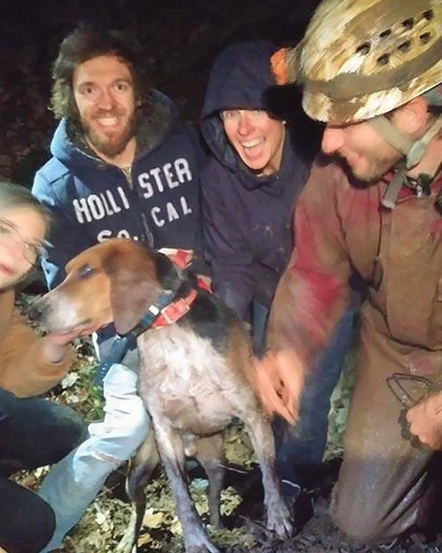 dog with his rescuers