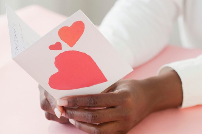 African woman holding Valentine's Day card