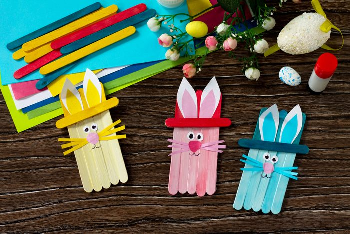 Easter bunny toy gift stics puppets on wooden table. Handmade. Project of children's creativity, handicrafts, crafts for kids.