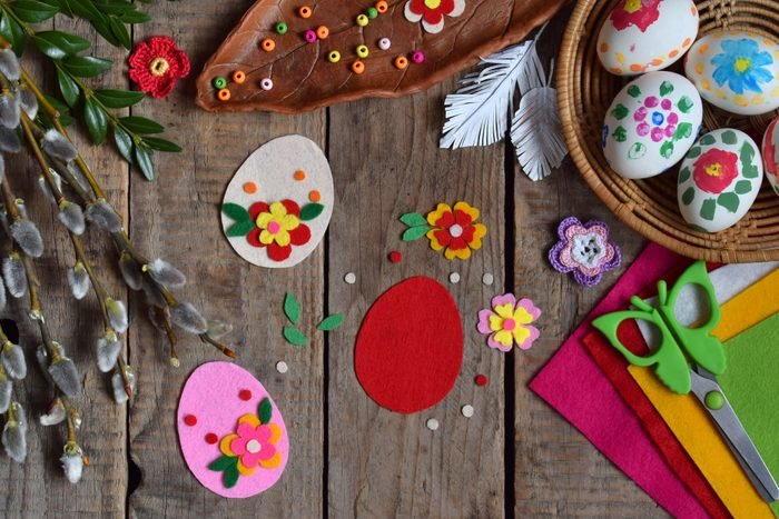 Making of handmade easter eggs from felt with your own hands. Children's DIY concept. Making Easter decoration or greeting card. Step 1. Cut out the egg.