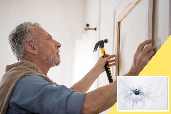 man hanging wall art