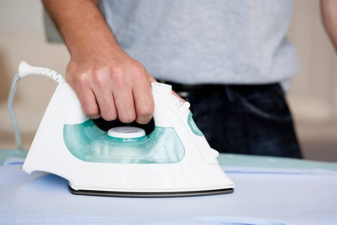 Man ironing close-up