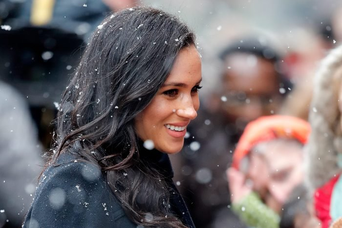 Meghan Markle in a crowd with snow falling